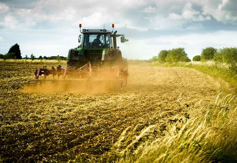 Clonmel Oil agricultural fuel photo of tractor plowing a field